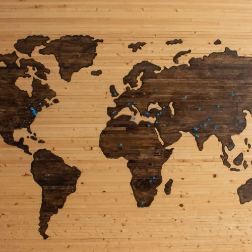 A picture of a wooden board with a map of the earth.